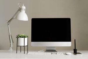 Designer workspace. Minimalistic home office. Blank screen desktop computer, Mockup desktop computer